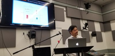 Myounghoon Jeon presenting From Kitchen to Aquarium: The Spectrum of Sonification across Information, Expression, Immersion during Session I talks